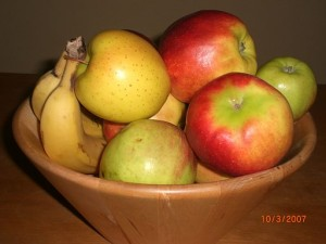 Apples and bananas in bowl