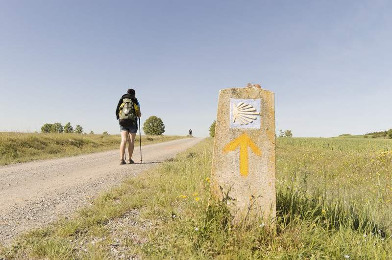 Pilgrim on the road to Santiago de Compostela in Castilla y Leon